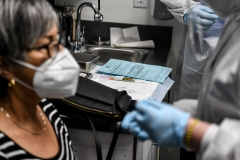 A COVID-19 vaccine is ready to be given to a volunteer at the Research Centers of America (RCA) in Hollywood, Fla. (Photo credit: CHANDAN KHANNA/AFP via Getty Images)
