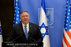 Secretary of State Mike Pompeo speaks to media in Jerusalem on Monday. During the visit he took time out to record a message for the RNC, aired on Tuesday night. (Photo by Debbie Hill/AFP via Getty Images)