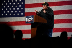 US filmmaker-author-activist Michael Moore, speaks to supporters of Democratic presidential candidate Senator Bernie Sanders at a campaign event in Clive, Iowa, on January 31, 2020. (Photo by JIM WATSON/AFP via Getty Images)