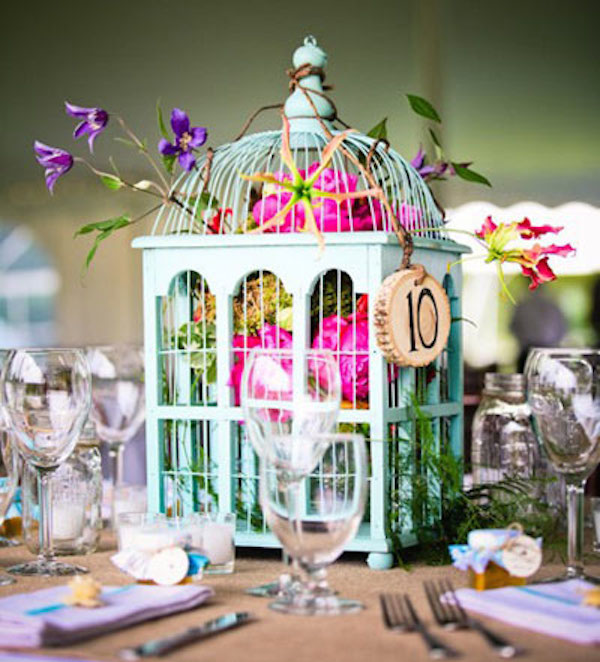 22 Eye-Catching & Inexpensive DIY Wedding Centerpieces: Floral Birdcage Wedding Centerpiece Idea | thegoodstuff