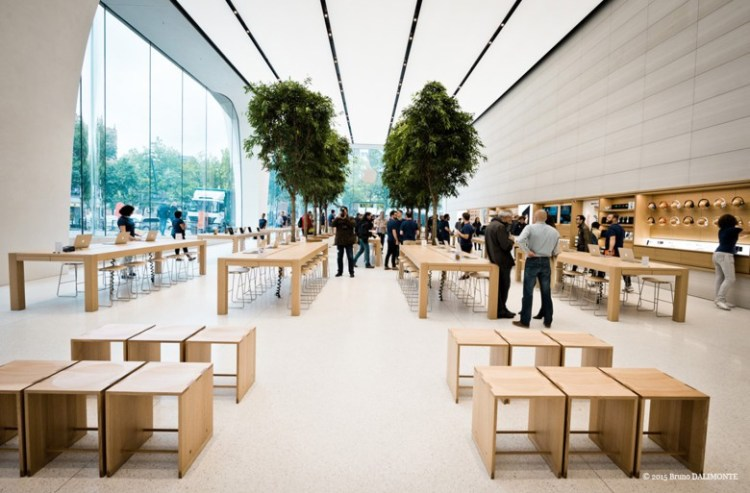 The Apple Store showroom in Brussels features trees and a greater use of wood.