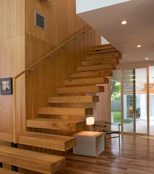 Use the space avialable beneath the floating staircase in more ways than one
