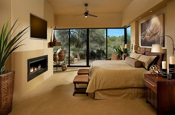 Area rug, ceiling fan, ceiling lighting, dark floor, earth tones, exposed beams, mantel, modern fireplace, recessed lighting, red bedding, sloped ceiling, vaulted ceiling, wood ceiling, wood flooring, stone color, even for exterior of house. African Inspired Interior Design Ideas