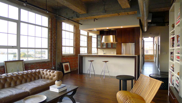 Industrial loft living room with a tufted sofa