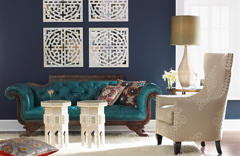 Beautiful teal chaise lounge placed in a living room with navy blue walls Hot Color Trends: Three Fashionable Hues That Serve You All Year Long Year Trends Three Serve Long Hues Fashionable Color