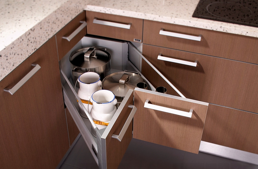 Butterfly corner drawers offer additional storage space Storage Tips For Small Kitchens