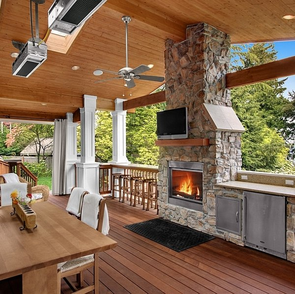 Stone fireplace next to the outdoor kitchen and a lovely ... on Covered Outdoor Kitchen With Fireplace id=60772