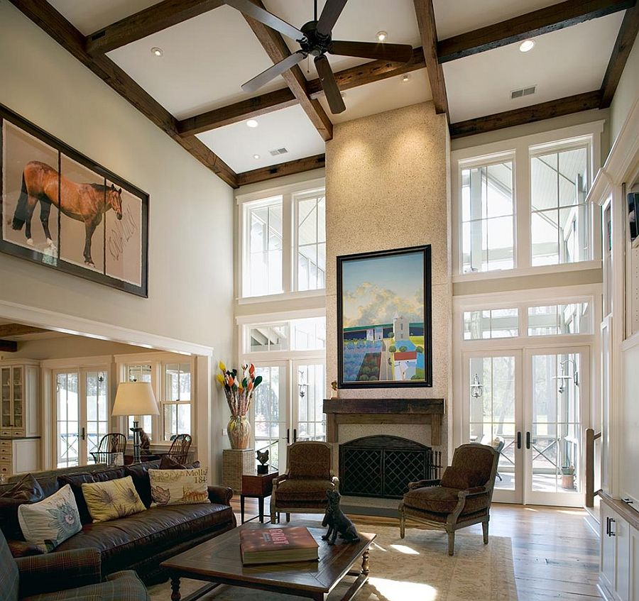 Sizing It Down  How to Decorate a Home with High Ceilings     ceiling beams and wall art combine to give the living room a stunning  ambiance