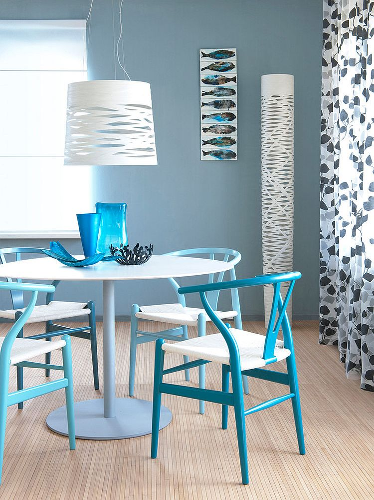 Classic Wishbone chairs in lovely blue steal the show in this small dining space [Design: Huis Styling]