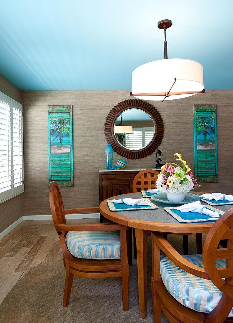 Dashing tropical style dining room with blue ceiling [Design: Karen Grace Interiors]
