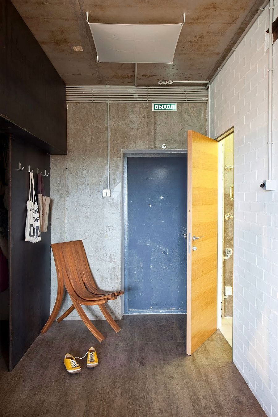 Small Modern Industrial Apartment Draped In Metal Wood