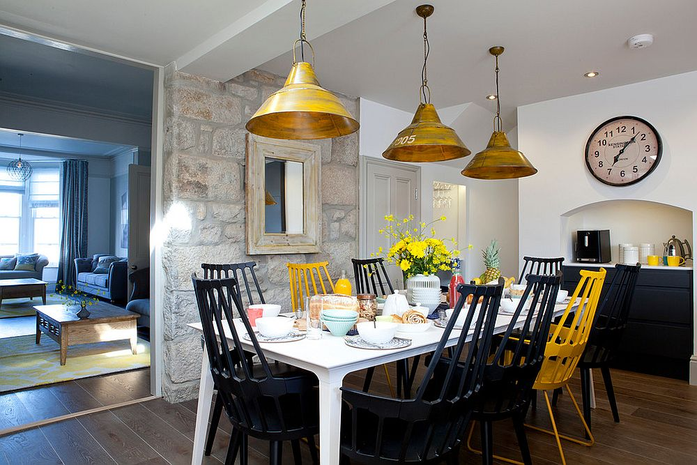 Beach Style Dining Room With Accent Stone Wall And