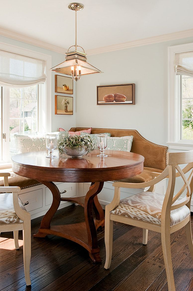 Traditional banquette in the kitchen corner with large round wooden table Storage Area In Kitchen