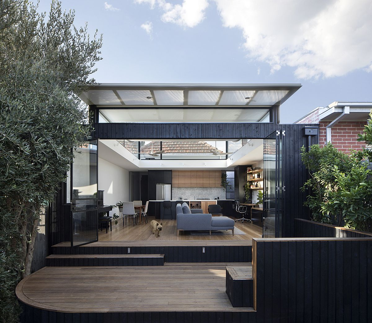 Contemporary rear extension of brick house in Melbourne with curved roof Roof that Curves Upwards Brings Light into This Revitalized Aussie Home