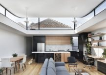 Open plan living area with kitchen and dining 217x155 Roof that Curves Upwards Brings Light into This Revitalized Aussie Home
