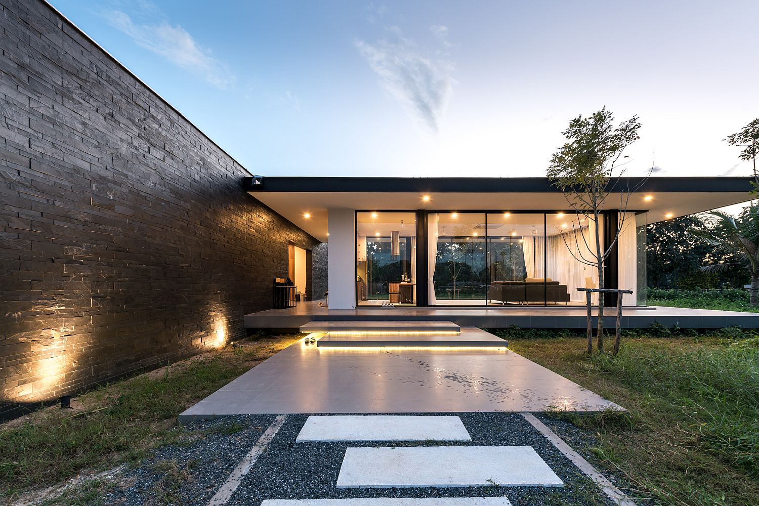 This Open Thai Home With Glass Walls Is Encircled By A