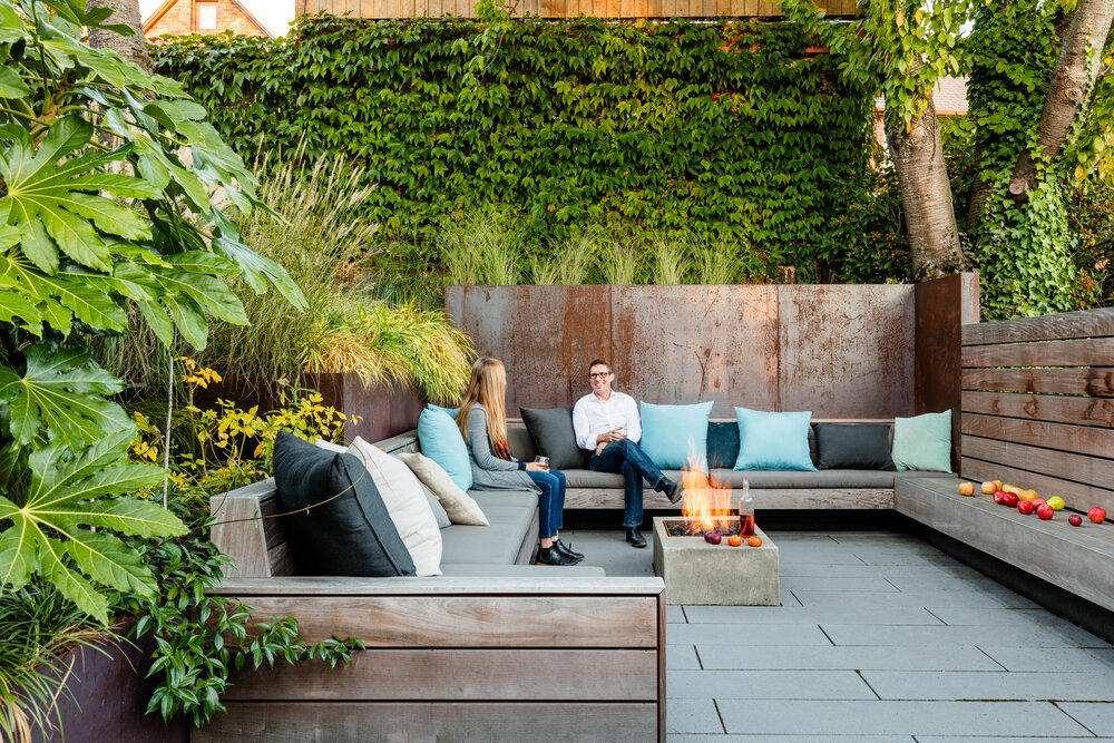 Secluded Outdoor Conversation Pit Surrounded by a Wall of ... on Green Wall Patio id=55984