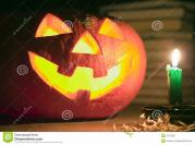 Creepy Pumpkin Near Candle Halloween Concept Stock