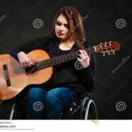 Disabled Girl Playing Guitar Stock