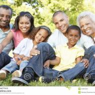 Multi Generation African American Family Relaxing Park