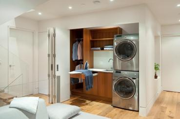 Sophisticated Hidden Laundry Room Closet Wooden