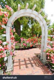 Wooden Garden Arch Pink Flower Stock