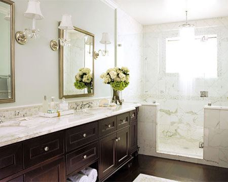 bathrooms - calcutta marble countertops lucite acrylic sconces silver mirrors frameless glass shower espresso cabinets calcutta marble shower surround green gray walls paint color