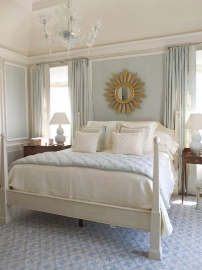 bedrooms - white poster bed blue rug gold sunburst mirror blue lamps blue silk drapes  Love this bedroom!  The bed, mirror, lamps.....everything!
