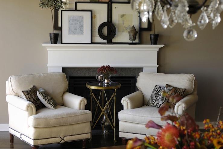 Graciela Rutkowski Interiors - living rooms - fireplace vignette, cheetah print, cheetah print pillows, cheetah pillows, fireplace seating, directoire table, brass directoire table, round directoire table, nailhead chairs, club chairs, linen club chairs, art on fireplace, fireplace art,