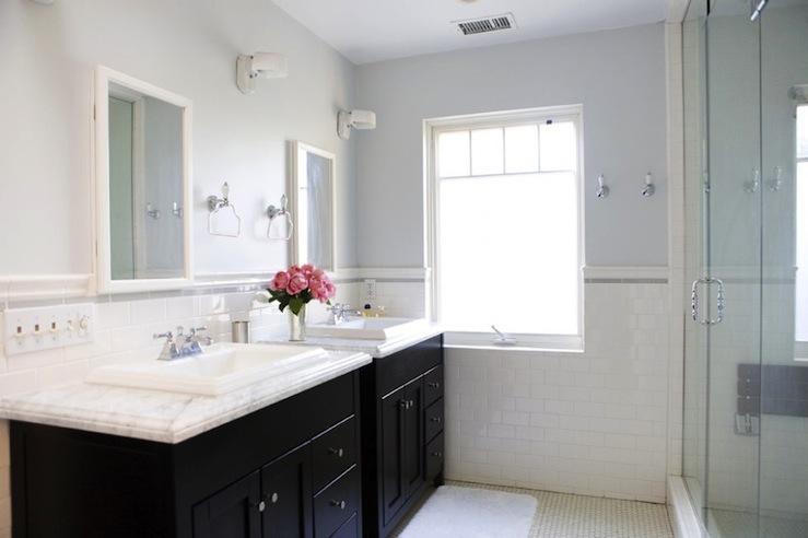 black bathroom vanity with white marble
