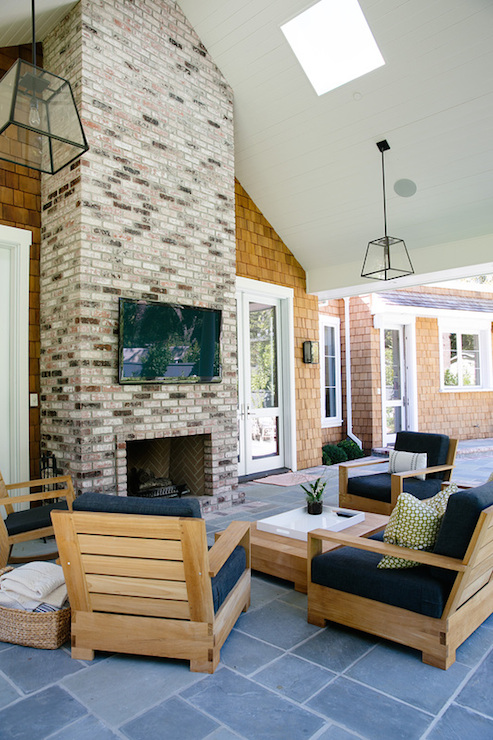 covered patio with fireplace cottage