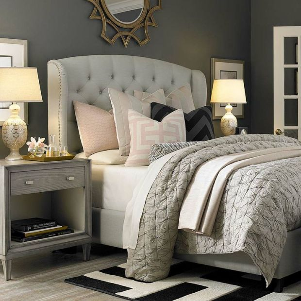 Transitional Style Bedroom Layered Bedspread Gray Greige Soft Pink Accents Pillows Bedside Tables Classic Side Table Lamps Black and White Accent Rug
