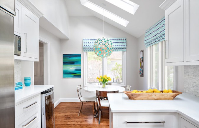 Dining Room Sloped Ceiling Design Ideas Contemporary breakfast nook boasts a sloped ceiling fitted with two  skylights accented with a David Trubridge Coral 400 Pendant Lamp  illuminating a round