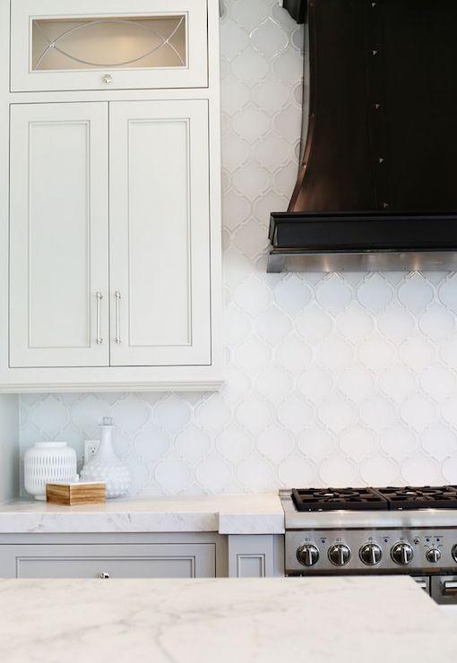 white arabesque tile backsplash