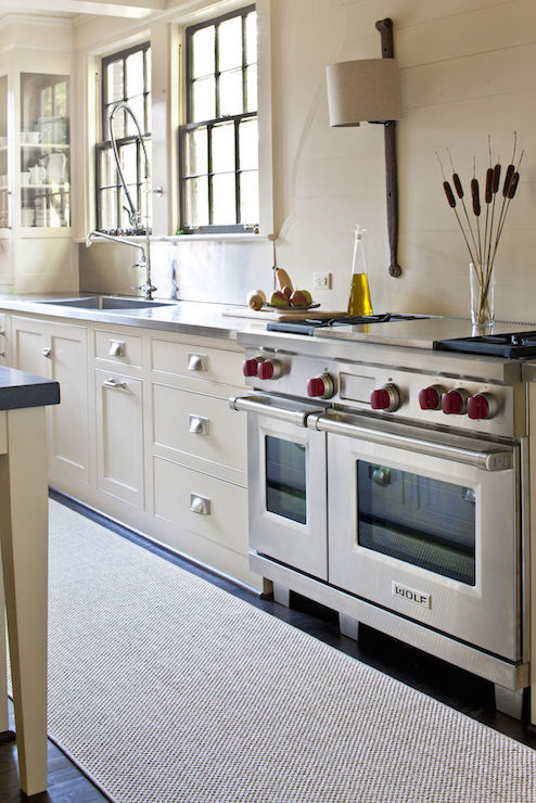 Cream Cabinets With Stainless Steel Countertops Transitional Kitchen
