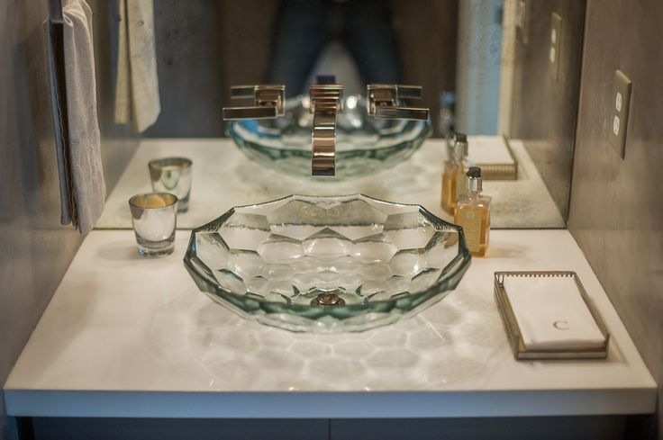 powder room with glass vessel sink