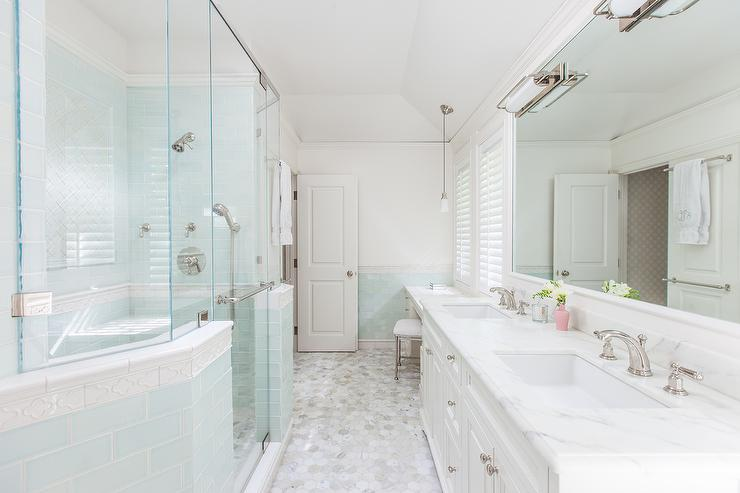 shower with blue glass subway tiles