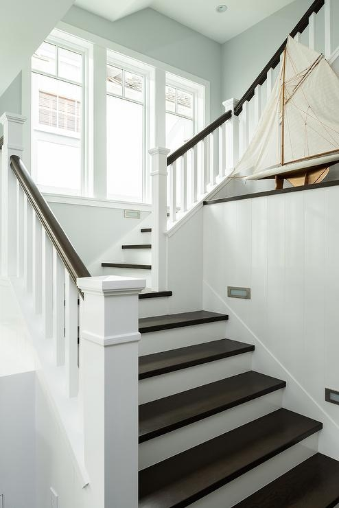Staircase With Art Ledge Country Entrance Foyer   White And Dark Wood Stairs   Medium Dark   Foyer   Stair Railing   Indoor   Traditional