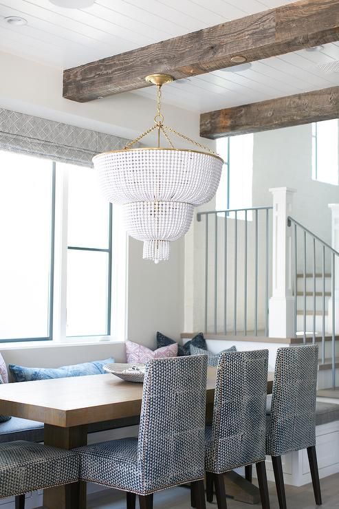 Built In Banquette With White Beaded Chandelier