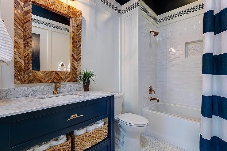 blue bathroom vanity with gold hardware