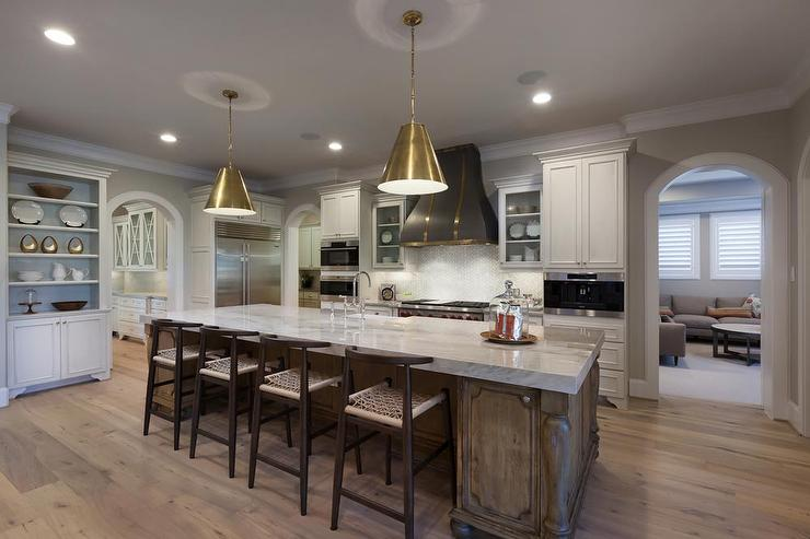 Gray Kitchen Hood With Brass Straps Transitional Kitchen