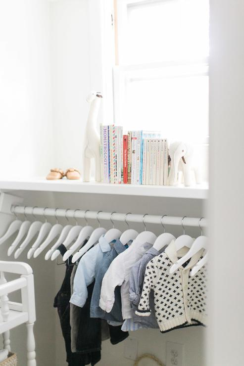 nursery closet with low clothes rail