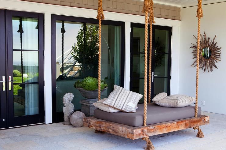 covered patio with swing bed