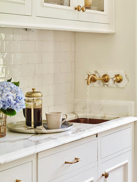 butler pantry with hammered copper sink