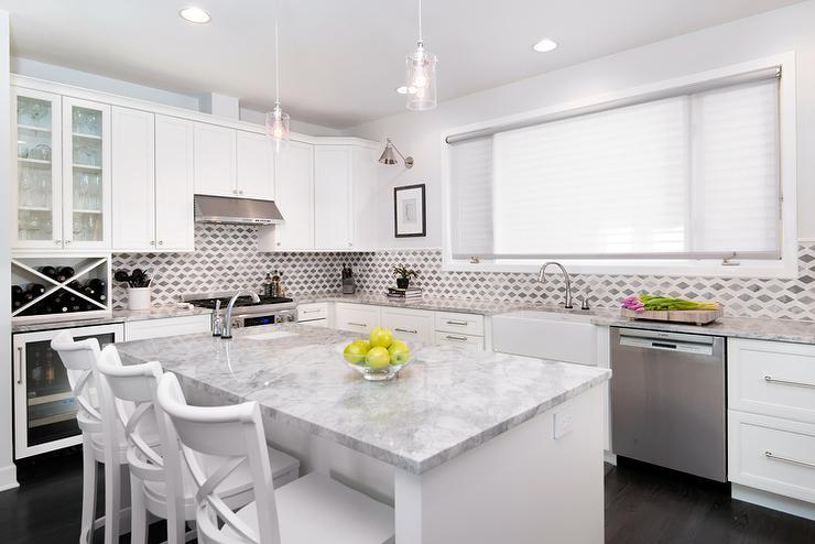 White Kitchen Cabinets With Super White Quartzite Countertops Transitional Kitchen