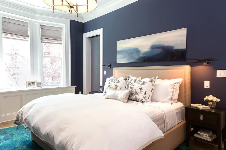 navy bedroom walls with beige nailhead headboard - contemporary