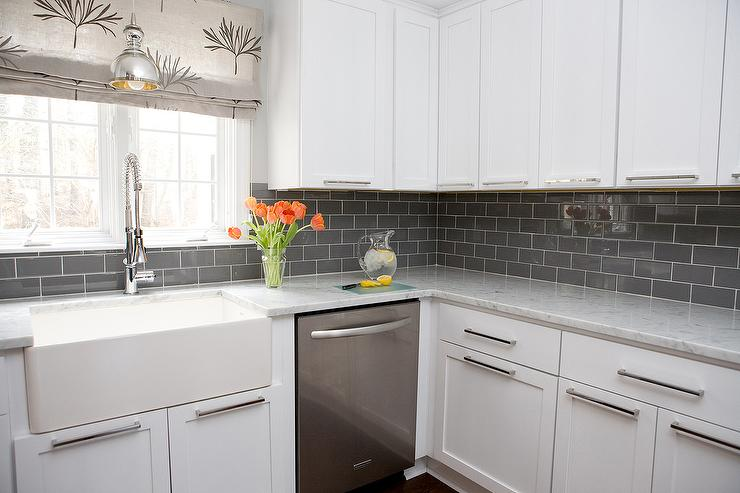 white kitchen cabinets with gray subway
