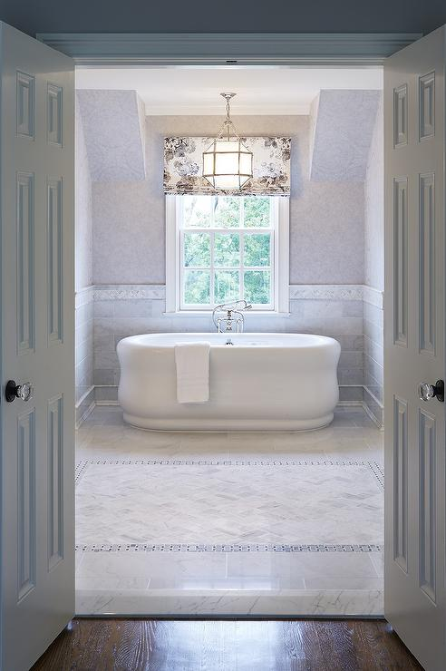 Tub Nook With Marble Wainscoting Traditional Bathroom