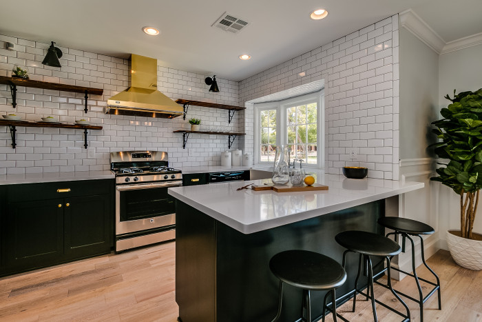 Black Cabinets With Gold Kitchen Hood Contemporary Kitchen