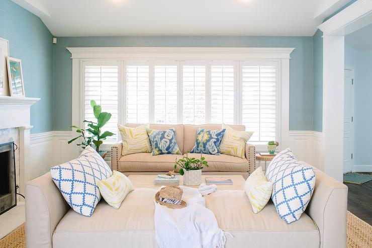Beige And Blue Living Room With Wainscoting